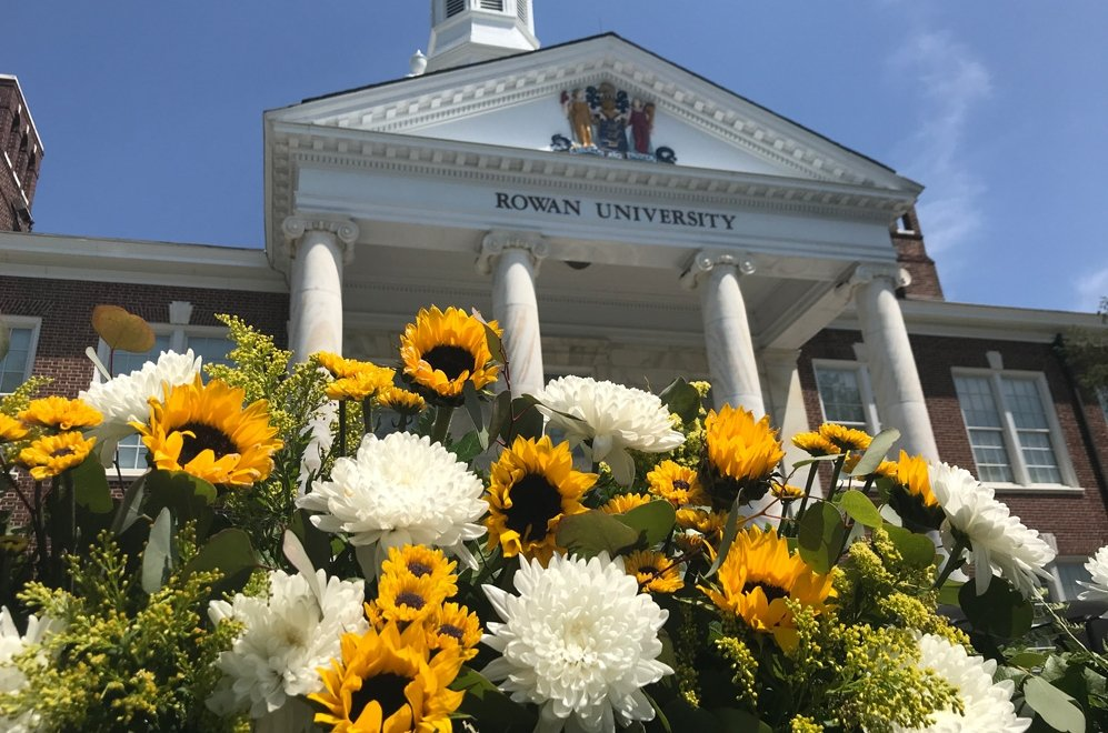 A close up of Bunce Hall and sunflowers.