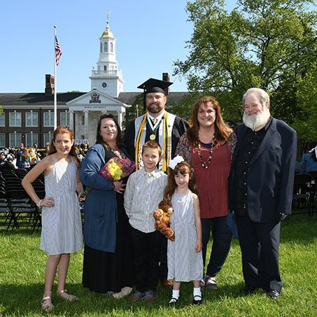 Jeremiah poses with his family at commencement