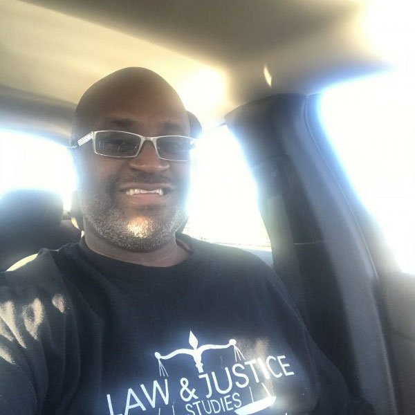 Carl wearing a Rowan Law and Justice t-shirt