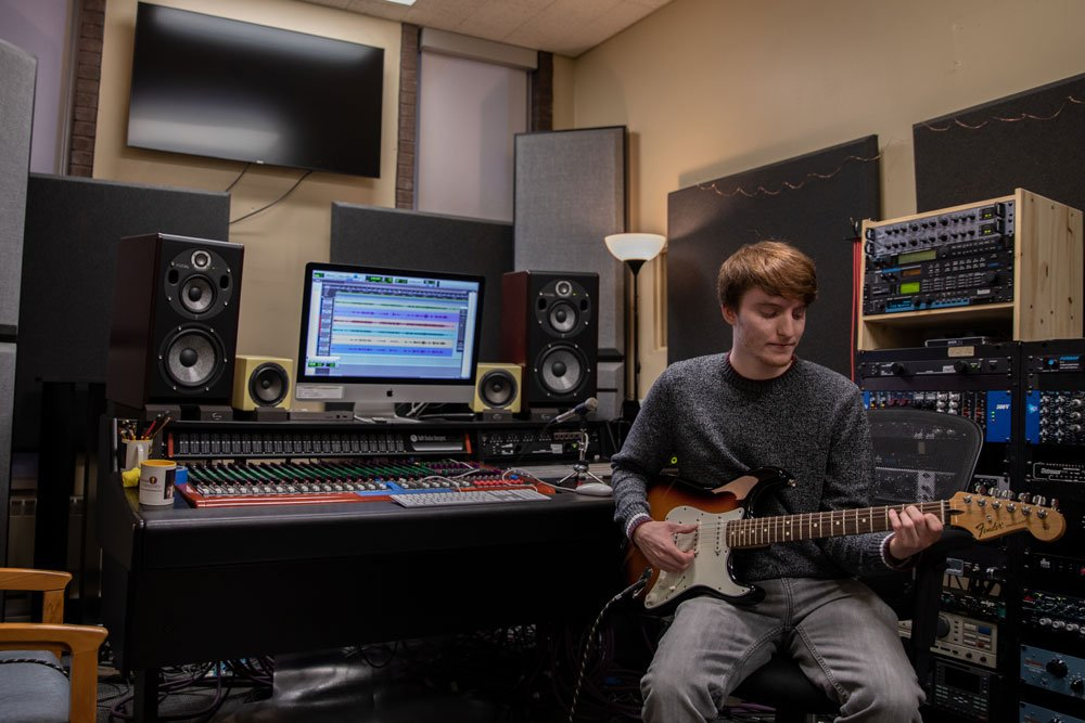 music composition student works in a studio